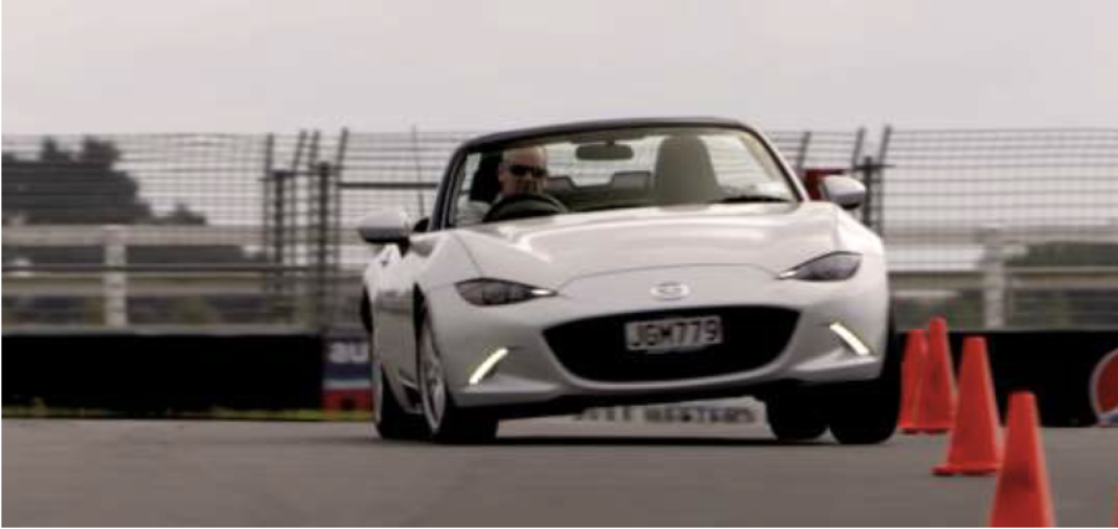 Drift a rear wheel drive Mazda MX5 with limited slip diff.