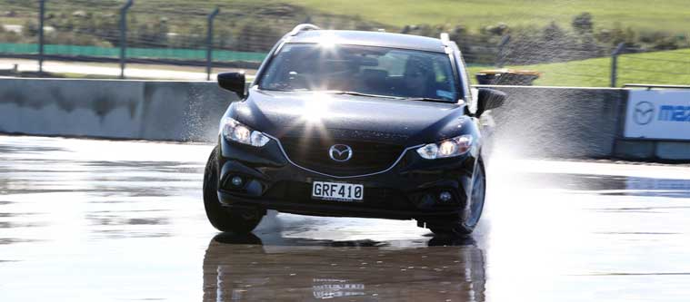 Skid pan driver training with Mazda6