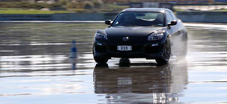 Skid pan driver training with Mazda RX8