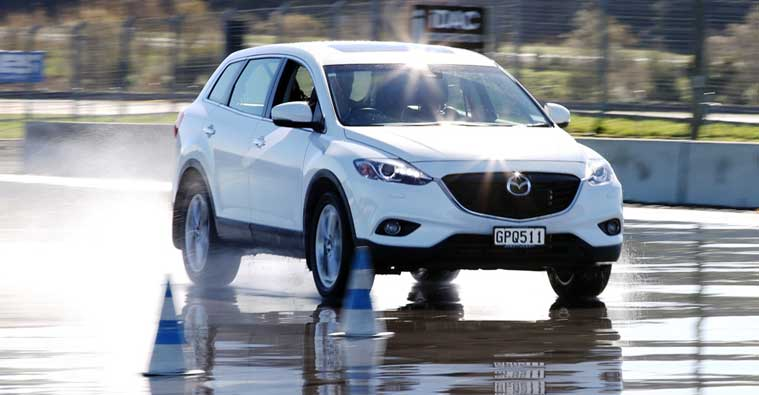 Skid pan driver training with Mazda CX9